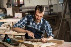 Carpenter at work Royalty Free Stock Image