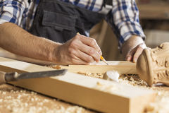 Carpenter at work. Young carpenter working with cutter in his studio Stock Image