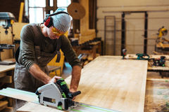 Carpenter by workbench Stock Photography