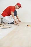 Carpenter worker joining parket floor Stock Photo