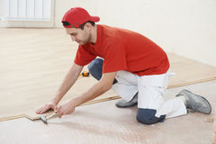 Carpenter worker joining parket floor Stock Image