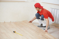 Carpenter worker joining parket floor Royalty Free Stock Photo