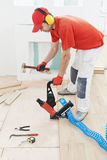 Carpenter worker joining parket floor Royalty Free Stock Image