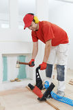 Carpenter worker joining parket floor Stock Photos
