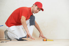 Carpenter worker joining parket floor Stock Photo