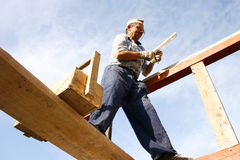 Carpenter working. At a new building with a box of tools and a spirit level Royalty Free Stock Photography