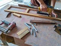 Carpenter working Air Nailer stock images