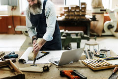 Carpenter working alone at workshop stock photography