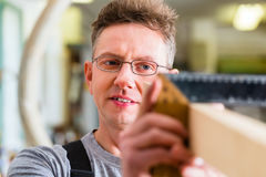 Carpenter working with angle Royalty Free Stock Photos