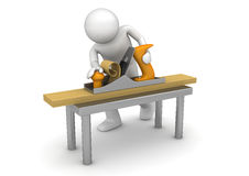 Carpenter working with bench plane Royalty Free Stock Photos