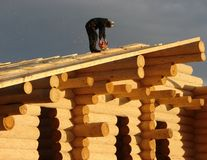 Carpenter working at cabin stock images