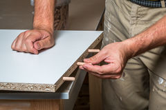 Carpenter working in the carpentry. Mesearing Royalty Free Stock Photo