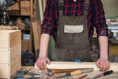 Carpenter working with a chisel. And hammer in a wooden workshop stock photo
