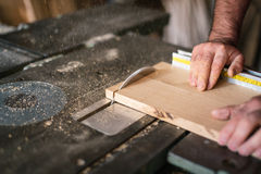 Carpenter working. On the circular saw Stock Images