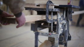Carpenter working with circular saw woodworking machine stock video footage