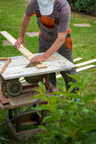 Carpenter working with electric buzz saw Stock Images