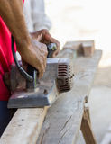 Carpenter working with electric planer Stock Images