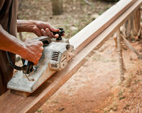 Carpenter working with electric planer Royalty Free Stock Photo