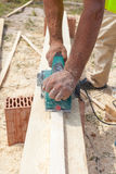 Carpenter working with electric planer. Carpenter working with electric planer Stock Photos