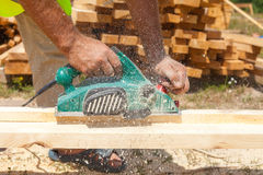 Carpenter working with electric planer. Carpenter working with electric planer Stock Photo