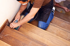 Carpenter working with electric sander Stock Photo