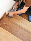 Carpenter working with electric sander Stock Image