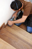 Carpenter working with electric sander Royalty Free Stock Images