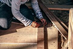 Carpenter working on floor Stock Photography