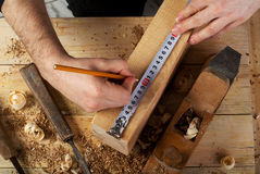 Carpenter working,hammer,meter and screw-driver on construction background.  Stock Photography