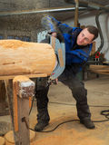 Carpenter is working with a hand circular saw Stock Photos