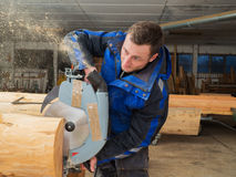Carpenter is working with a hand circular saw Royalty Free Stock Photos
