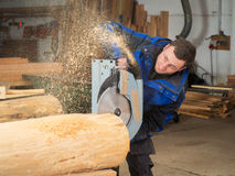 Carpenter is working with a hand circular saw Stock Photography