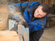 Carpenter is working with a hand circular saw Royalty Free Stock Photography