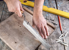 Carpenter working on a hand saw Stock Photo