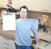 A Carpenter working hard at the shop Stock Photos