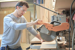 A Carpenter working hard at the shop Royalty Free Stock Images