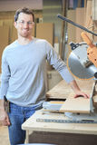 A Carpenter working hard at the shop Royalty Free Stock Photos