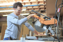 A Carpenter working hard at the shop Royalty Free Stock Image