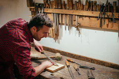 Carpenter working hard with tools in his carpentry Royalty Free Stock Photography