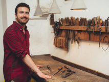 Carpenter working hard with tools in his carpentry Stock Photos