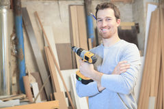 A carpenter working hard at the workshop. Holding a tool on the hand Royalty Free Stock Photos