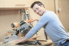 A carpenter working hard at the workshop Stock Images