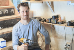 A carpenter working hard at the worksop Stock Photo