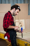Carpenter working on his craft Stock Photos