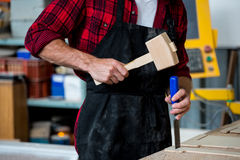 Carpenter working on his craft Royalty Free Stock Photo