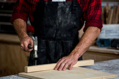 Carpenter working on his craft Royalty Free Stock Photos
