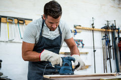 Carpenter working on his craft Stock Image