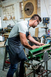 Carpenter working on his craft. In his workshop Royalty Free Stock Photography