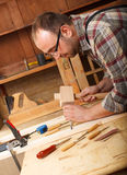 Carpenter working in his workshop Royalty Free Stock Photography