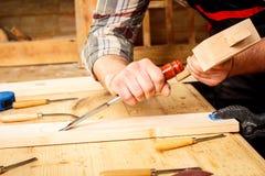 Carpenter working in his workshop Stock Image
